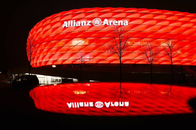 Allianz Arena in red light, football stadium in Munich, Germany. Night reflection