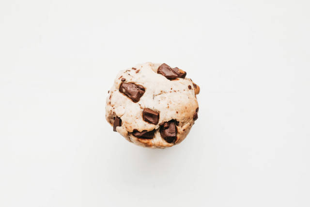 Top view of vegan homemade chocolate chips cookie on white background