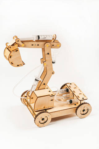 Wooden toy excavator on white background
