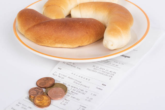 Croissants with reciept and coins on white background