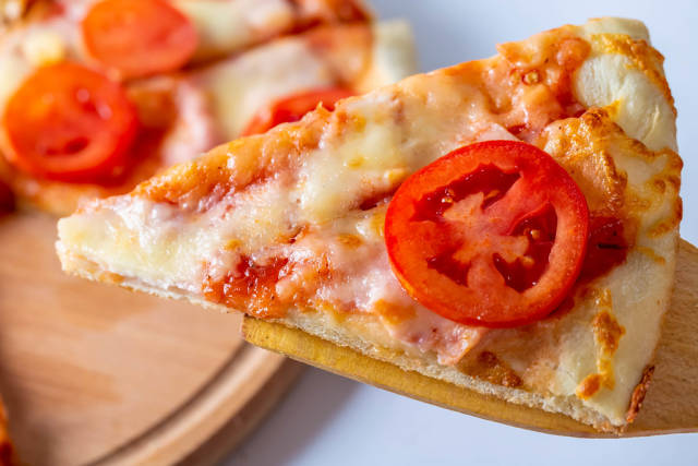 Piece pizza with bacon and fresh tomato