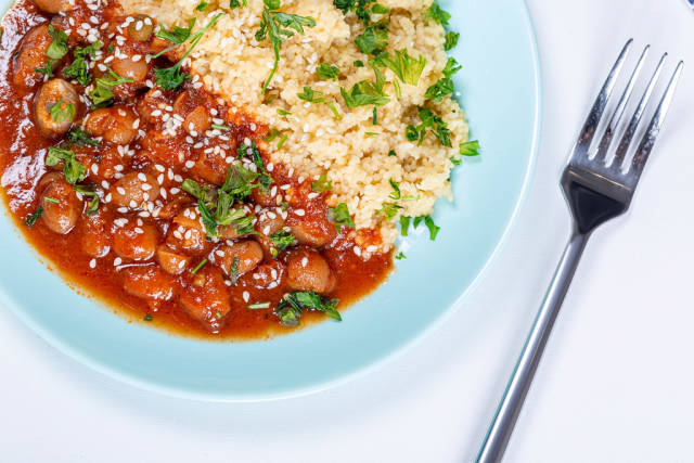 Couscous with beans in tomato sauce and herbs