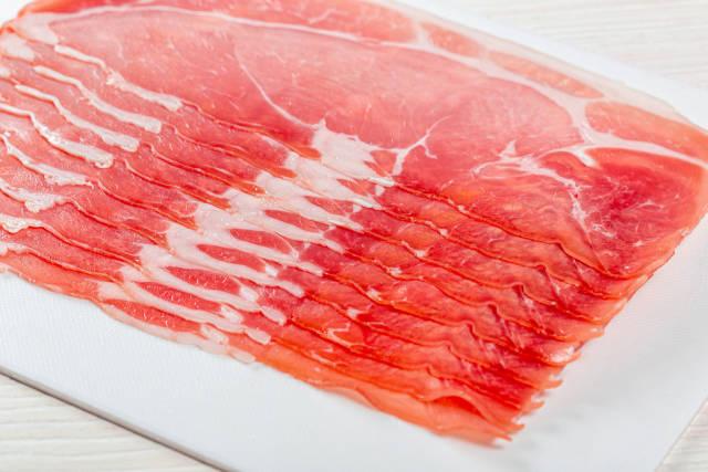 Sliced on the slicer dry-cured ham