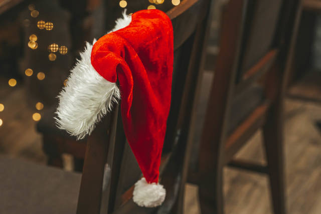 Close-up, santa claus hat on the back of a chair