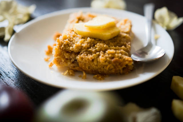 Piece of baked apple crisp on a plate