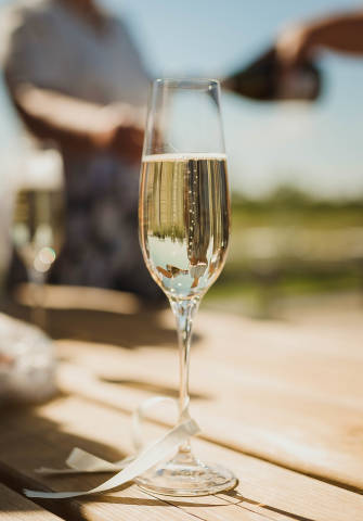 Close Up Of Champagne Glass On The Wooden Table