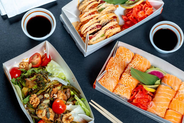 Sushi rainbow dragon and Philadelphia with vegan salad