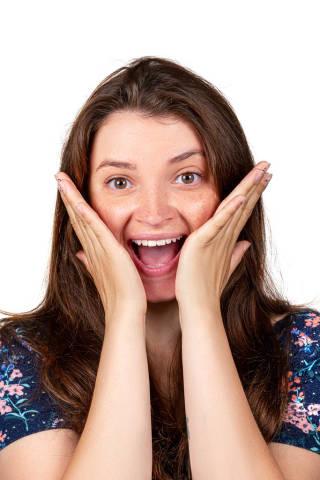 Portrait of a laughing girl. The concept of joy, pleasant surprise