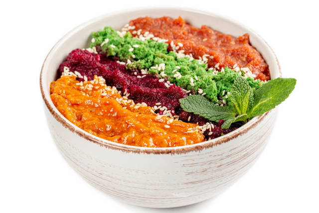 Healthy breakfast bowl, oatmeal and multi-colored fruit purees