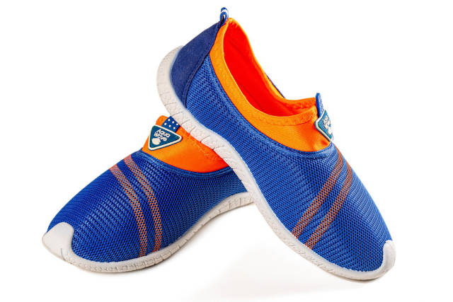 Boyish casual sports sneakers of blue-orange color on white background