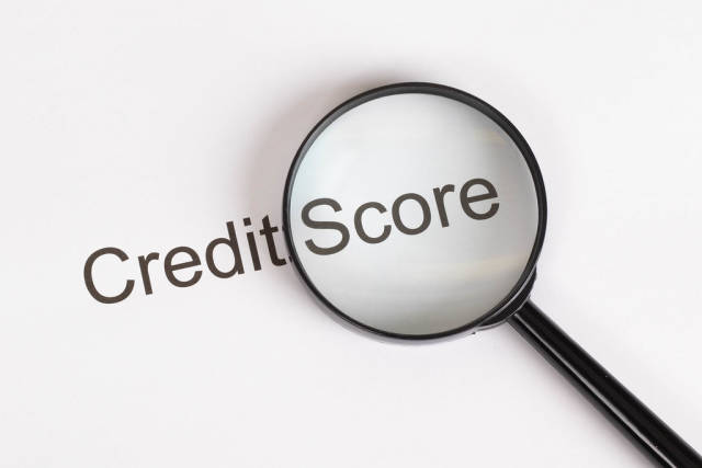 Credit Score text under magnifying glass