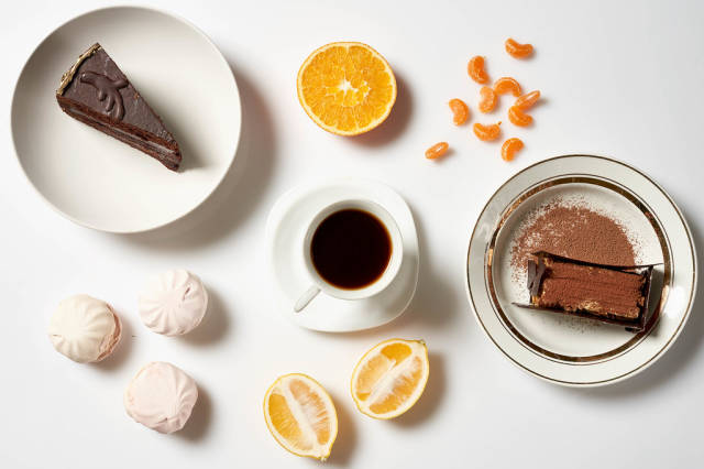 Tasty chocolate cakes, homemade zephyr sweets and a cup of coffee