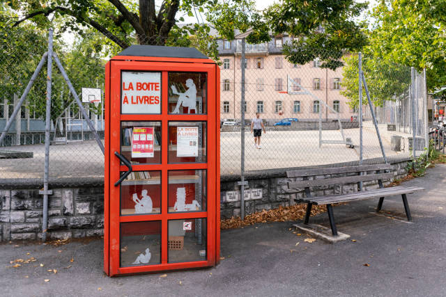 Red bookcrossing booth at the city center of Sion