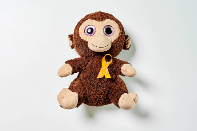 Kids plush monkey toy with yellow ribbon - Childhood Cancer Day
