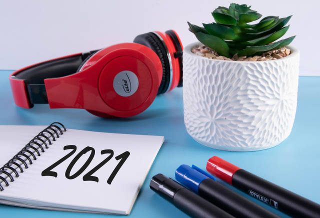 Headphones, flower and notebook with 2021 text