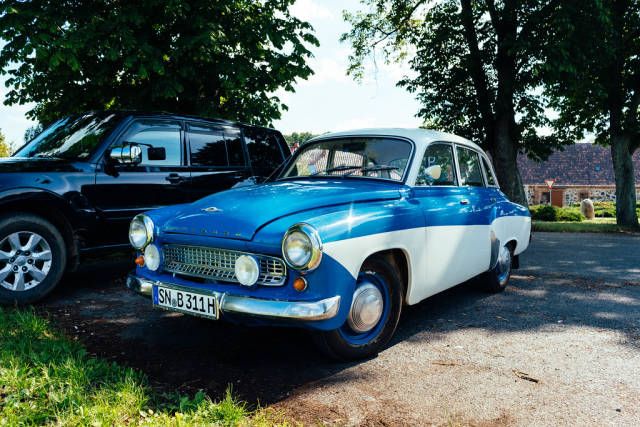 Old retro car from East German manufacturer Wartburg parked in German countryside