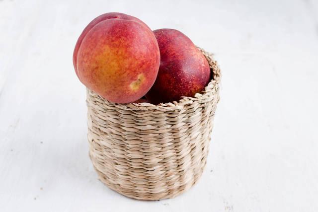 Fresh peach fruit in basket