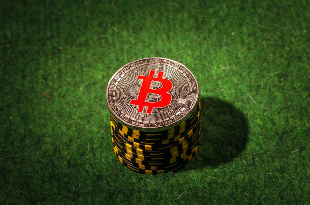 Silver Bitcoin on the stack of poker chips