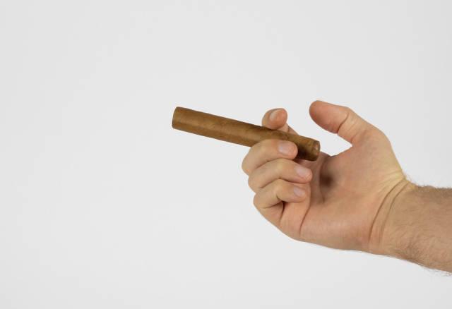 Hand holding cigar