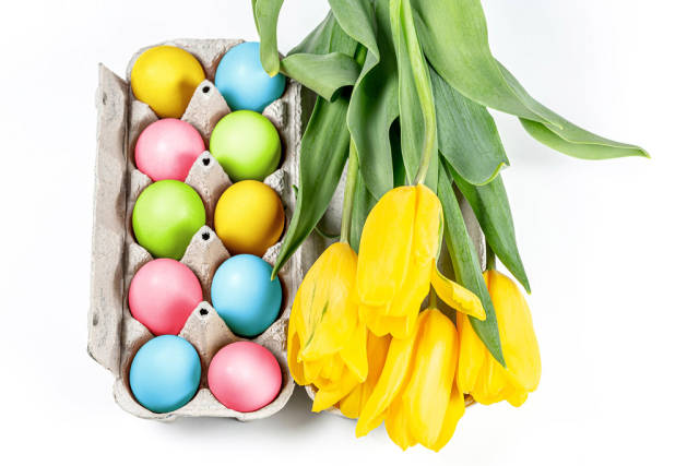 Colorful Easter eggs with a bouquet of tulips