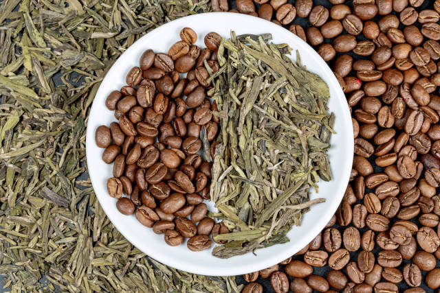 Dried green tea and coffee beans background