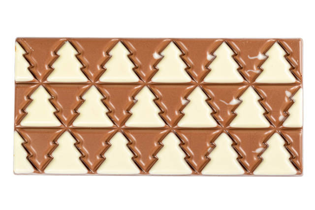 Christmas chocolate bar with christmas trees, top view
