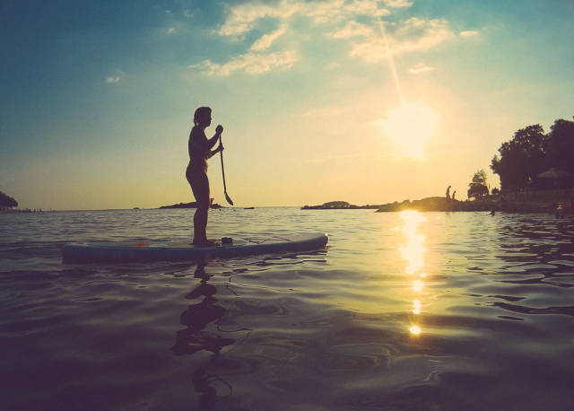 Silhouette of a woman on stand up paddle board