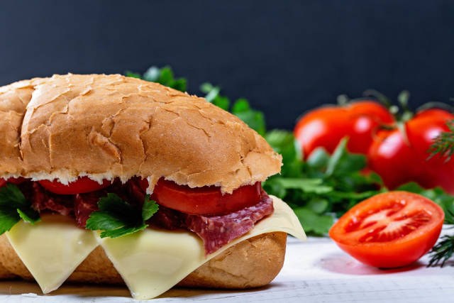 Close-up of sandwich with salami, cheese and vegetables