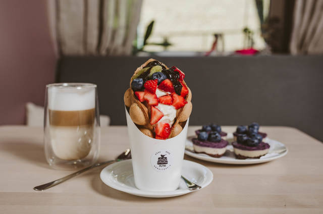 Hong kong or bubble waffle with ice cream and fruits.