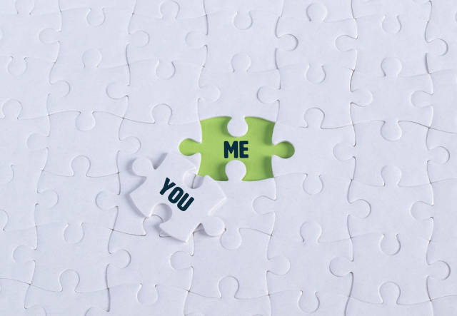 White puzzle with word You & Me