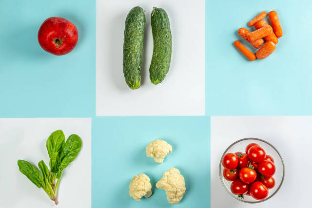 Top view, vegetarian food on blue and white background