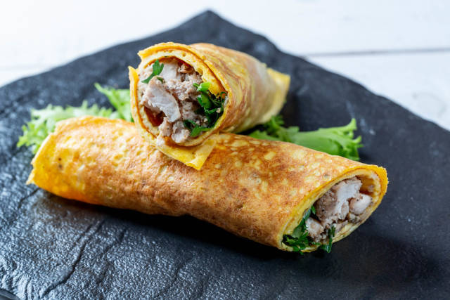 Egg omelet with meat and herb filling
