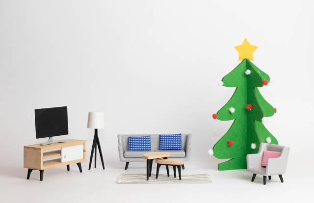 Sofa beside a Christmas tree