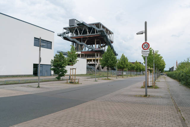 Street in Hannover with abandoned Expo 2000 pavilion of Netherlands in the background