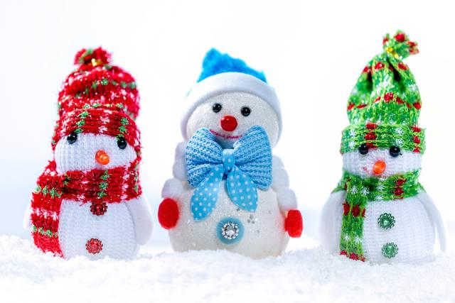 Three snowmen in the snow