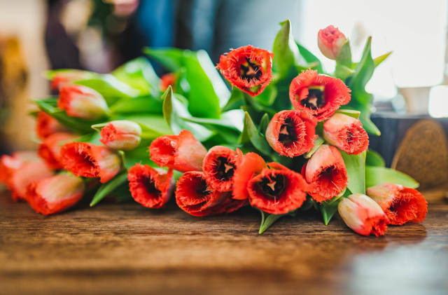Bunch Of Red Tulips On The Wooden Table