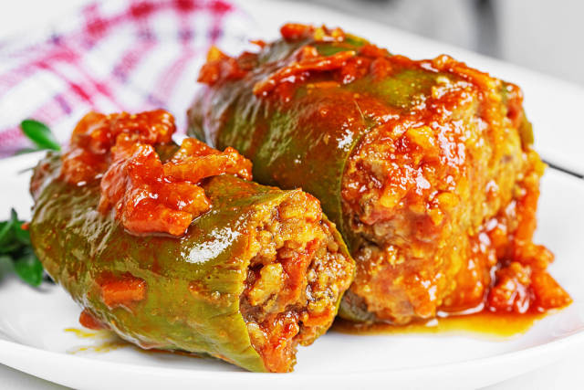Stuffed peppers with vegetables, meat and tomato sauce