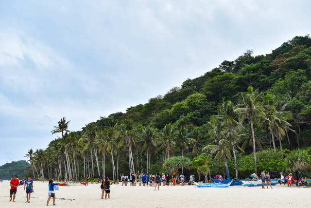 Tourists enjoying at Puka Boracay Beach