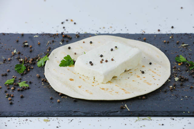 Sheep cheese and Lebanese pita with peppercorn and parsley