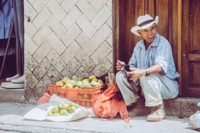 A Man Selling Mandarins