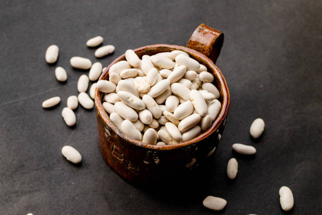 Group of white beans in a ceramic cup