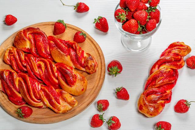 Fresh homemade buns with strawberry jam and fresh strawberries