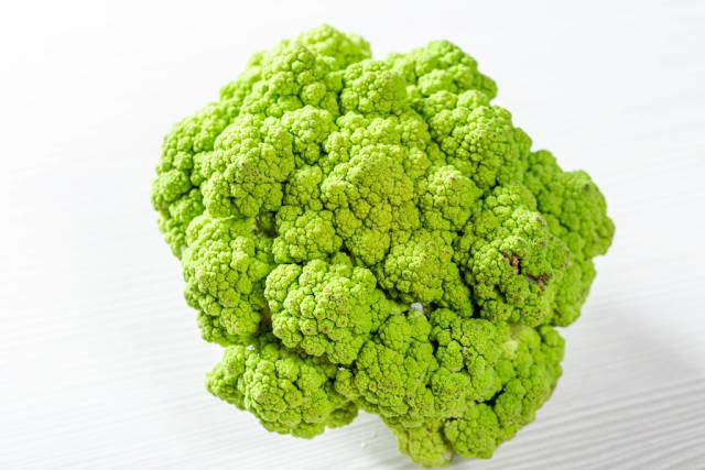 Fresh green broccoli on light wooden background
