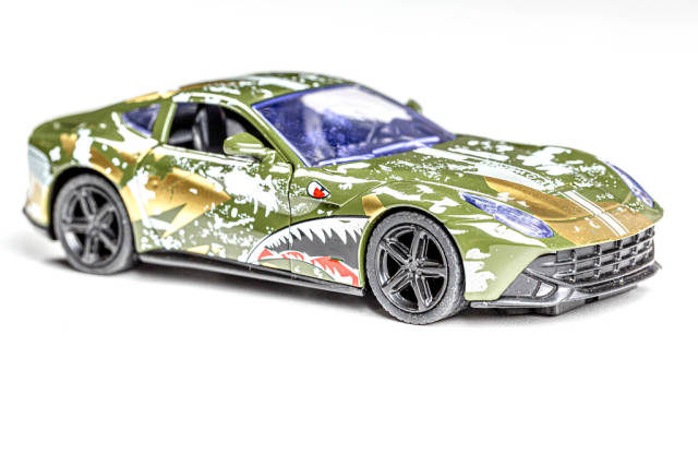 Metal car-toy for children on a white background