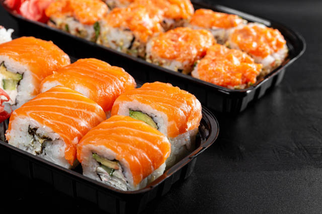 Sushi in plastic containers, close-up
