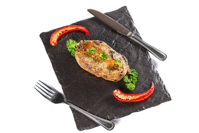 Grilled pork meat with fresh parsley and hot pepper