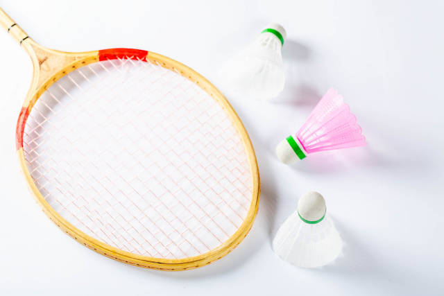 Top view badminton racket and shuttlecocks.