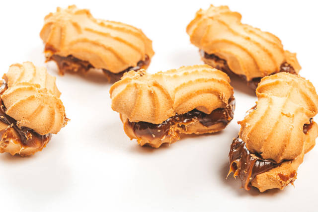 Shortbread cookies with condensed milk on white