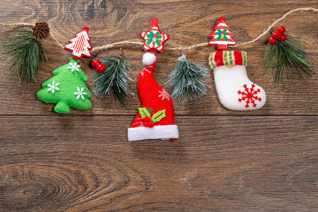 Christmas decor hanging on string on brown wooden background