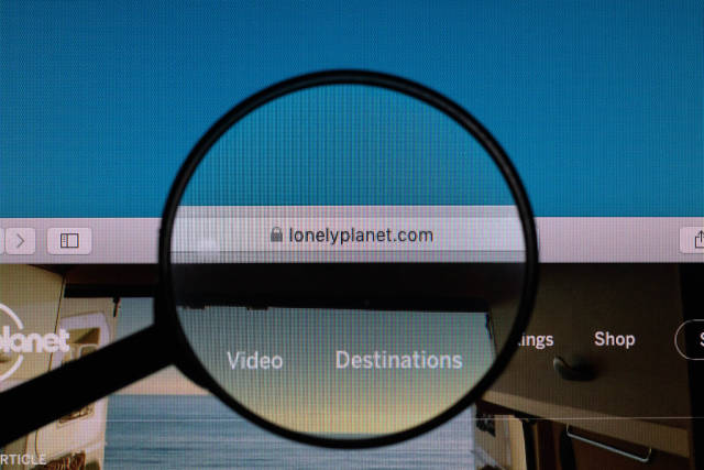Lonely Planet website under magnifying glass
